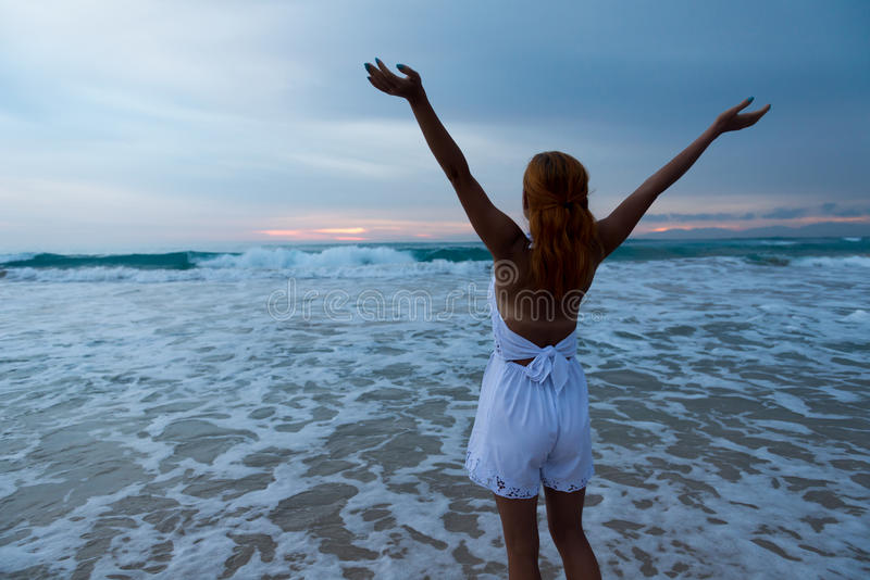 Download Young Woman Standing On Ocean Beach Royalty Free Stock Photos - Image: 38563688