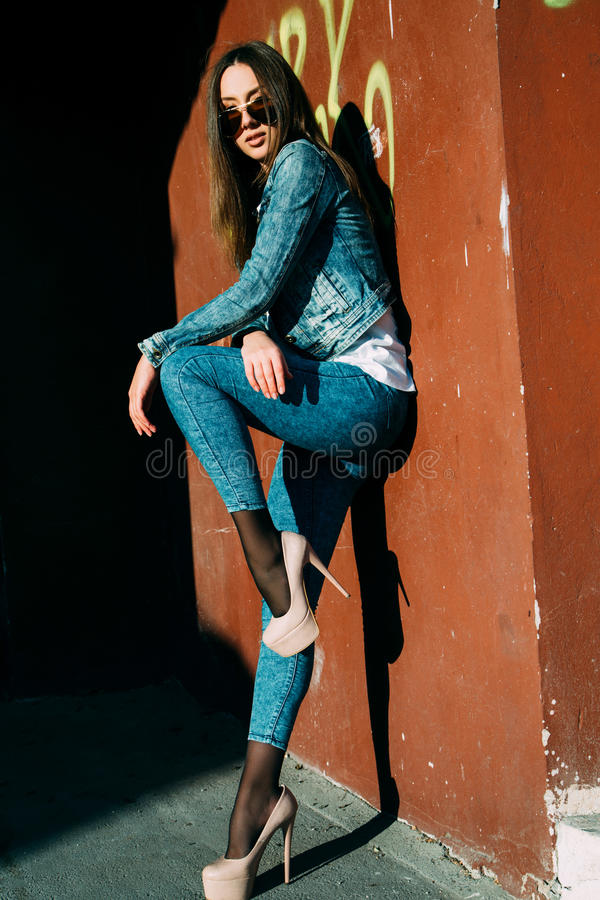 Young woman standing outdoors. fashion portrait. royalty free stock image
