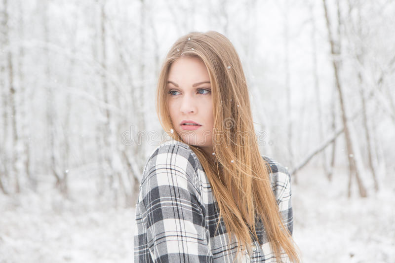 Download Young Woman Standing In Outdoors In The Snow. Stock Photo - Image: 83720076