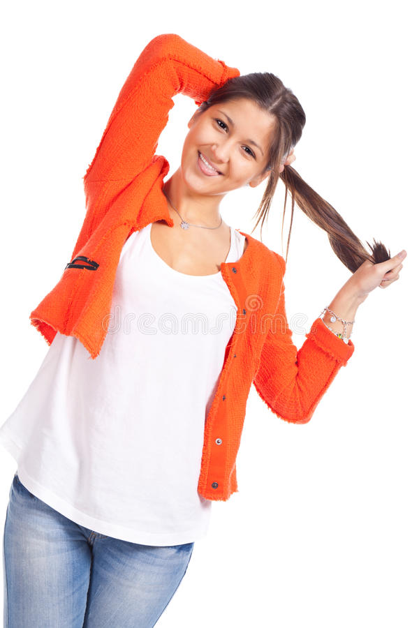 Young woman standing and playing with hair stock image
