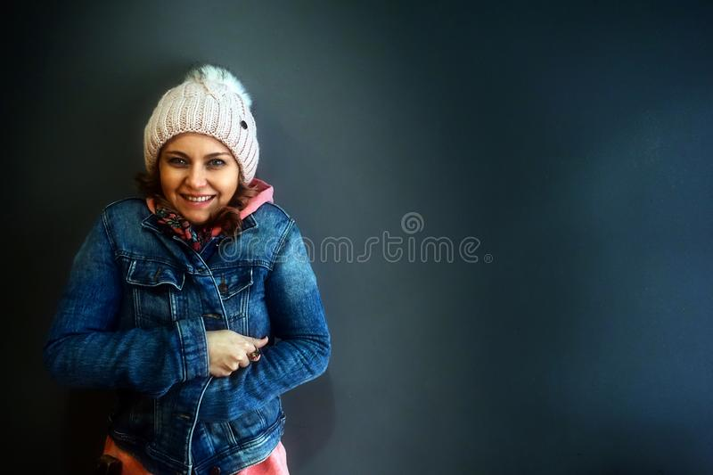 Young Woman Standing and Smiling with Jacket royalty free stock images
