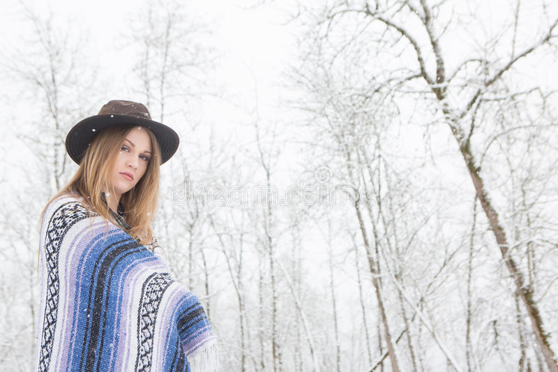 Download Young Woman Standing In Snow With Bohemian Style Hat And Blanket. Stock Photo - Image: 83719974