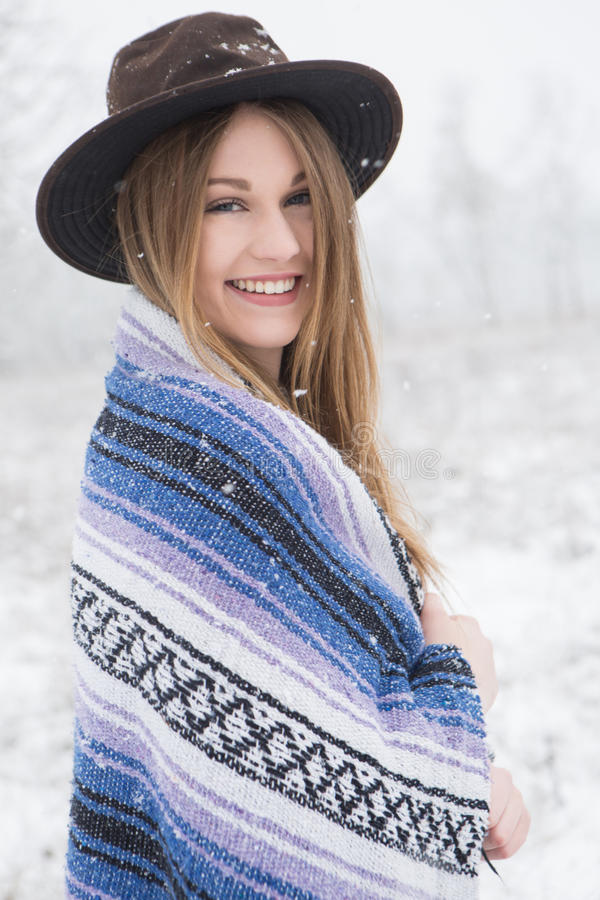 Download Young Woman Standing In Snow With Bohemian Style Hat And Blanket. Stock Photo - Image: 83720072