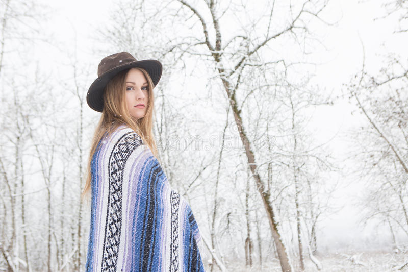 Download Young Woman Standing In Snow With Bohemian Style Hat And Blanket. Stock Photo - Image: 83720486