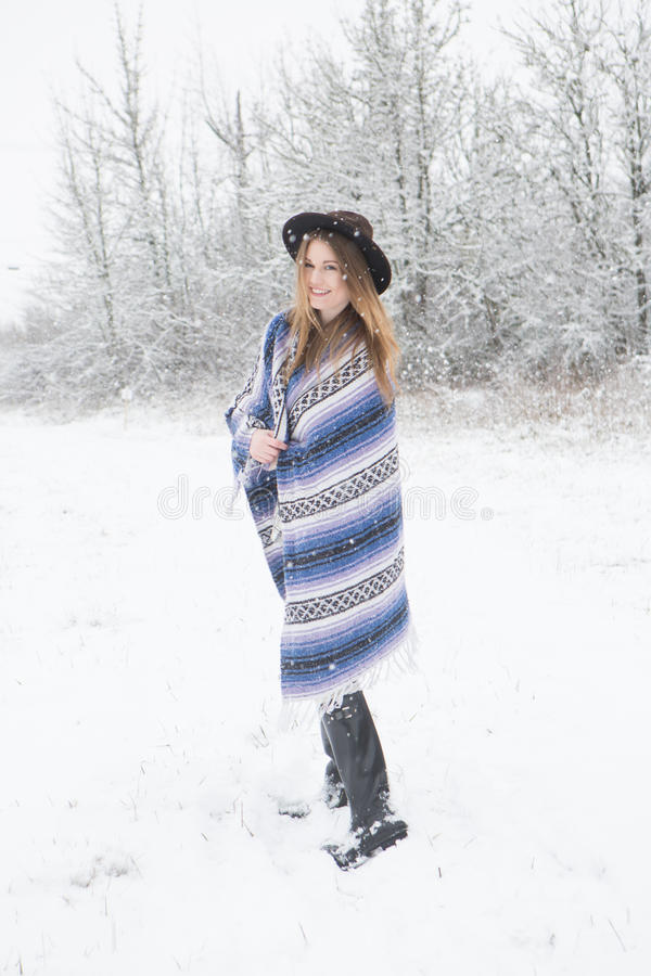 Download Young Woman Standing In Snow With Bohemian Style Hat And Blanket. Stock Photo - Image: 83720505