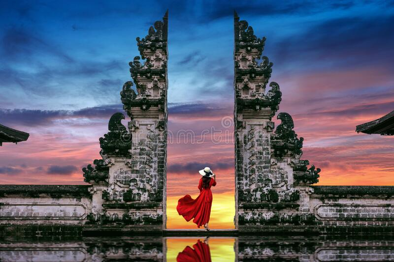 Young woman standing in temple gates at Lempuyang Luhur temple in Bali, Indonesia royalty free stock photography