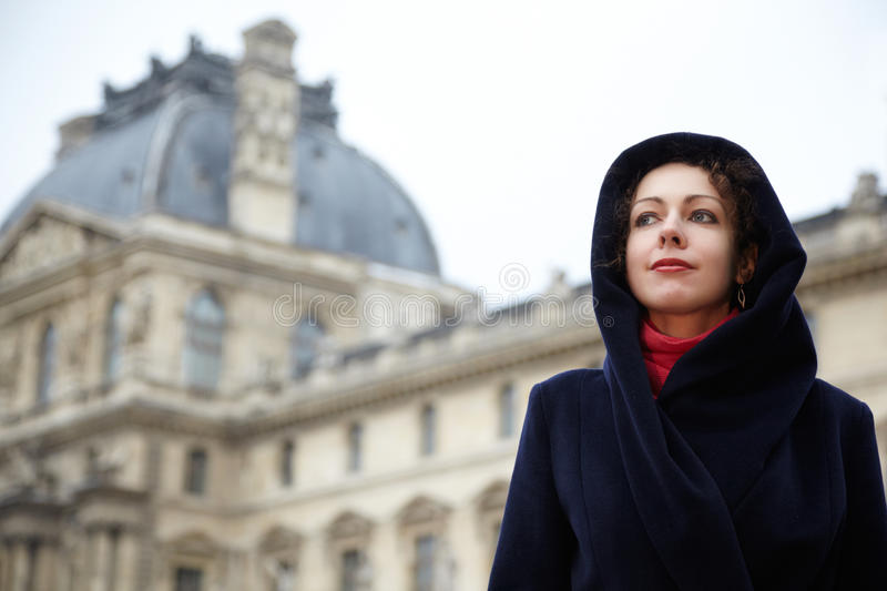 Young woman stands in courtyard of Louvre stock images