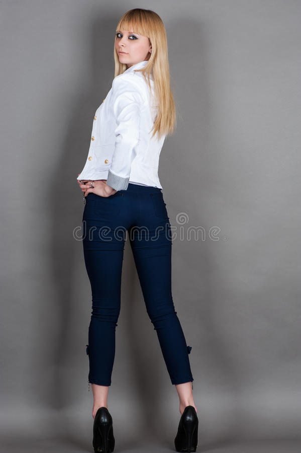 young woman stands full length half turn royalty free stock photo