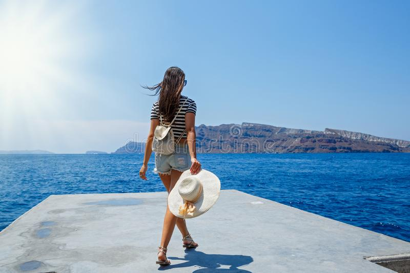 Young woman stands on the pier stock images