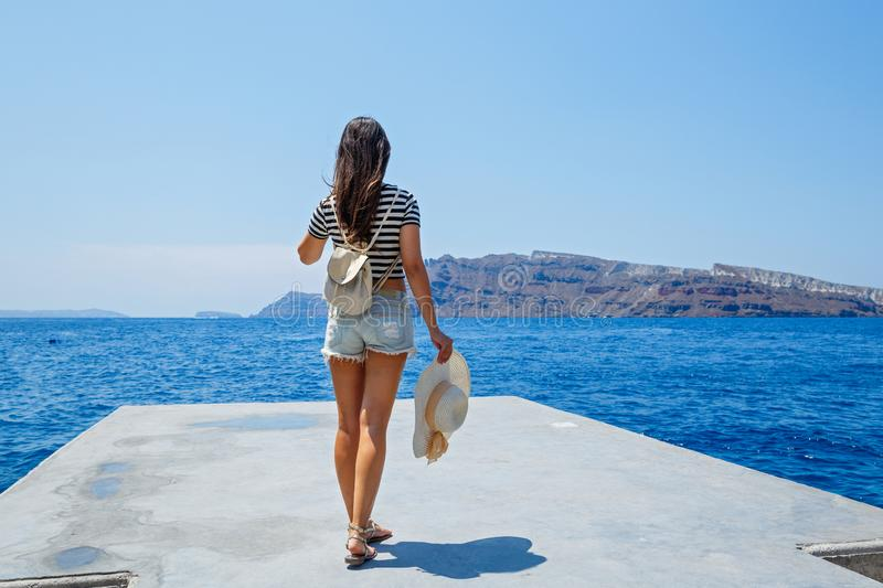 Young woman stands on the pier stock photography