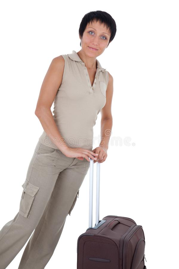 Young woman stands with traveling suitcase isolate