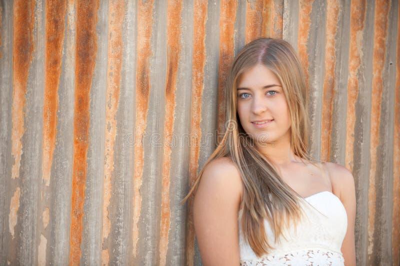 Young woman staring at camera stock photo