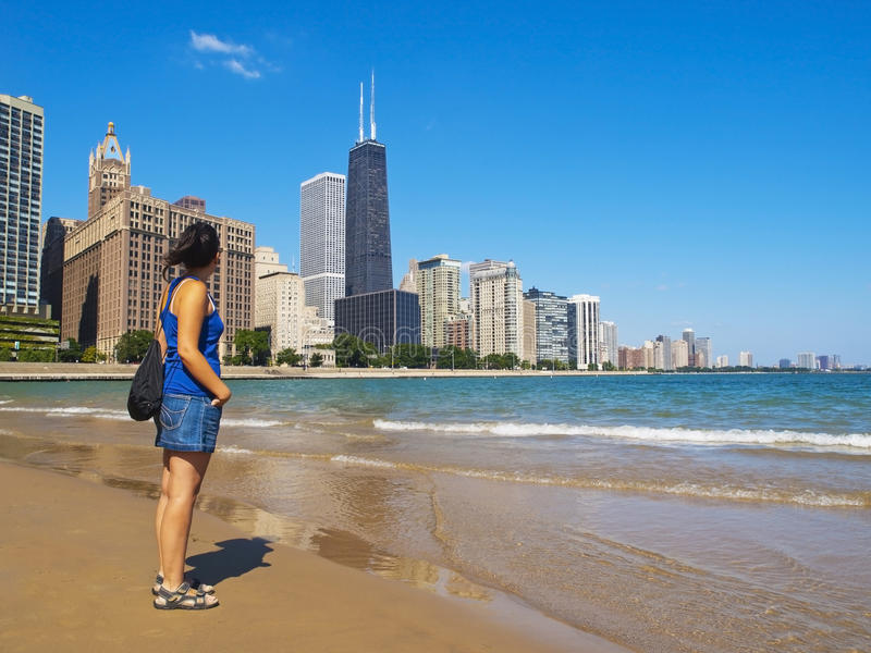 Young woman staring at the Chicago Skyline stock photos