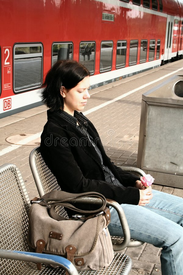 Young woman at the station 2 royalty free stock photo