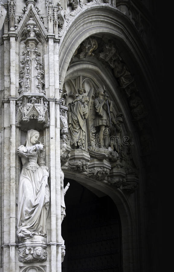 Young woman statue of gothic facade. Architecture detail of gothic facade of public historical building on Grand Place in Brussels with young woman statue in the royalty free stock photos