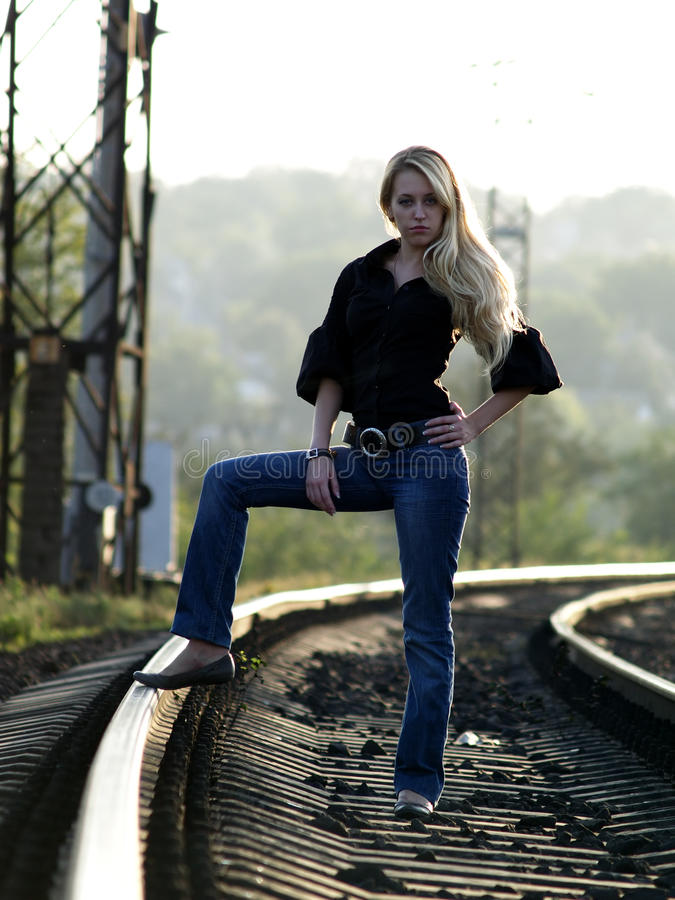 Free Young Woman Staying On Railway Royalty Free Stock Photos - 10988758