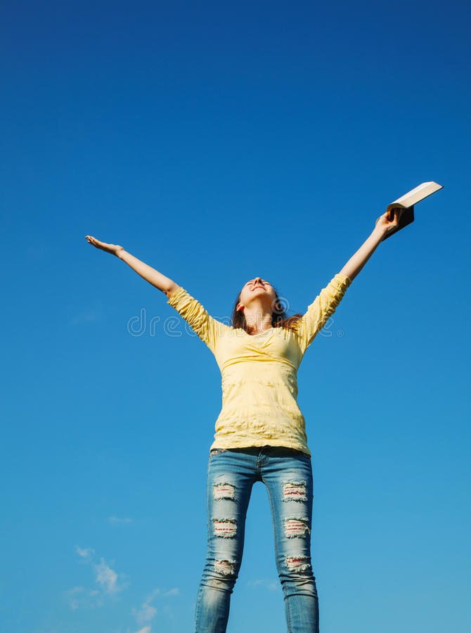 Download Young Woman Staying With Raised Hands Stock Photo - Image: 29194266