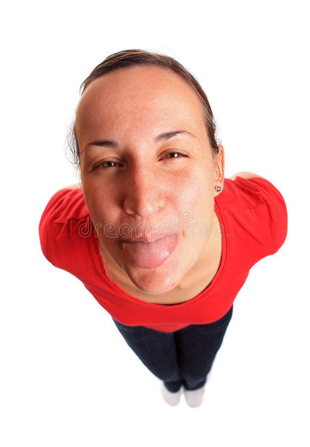 Young woman sticking her tongue out. Portrait of a young pretty caucasian woman stick her tongue out royalty free stock photography