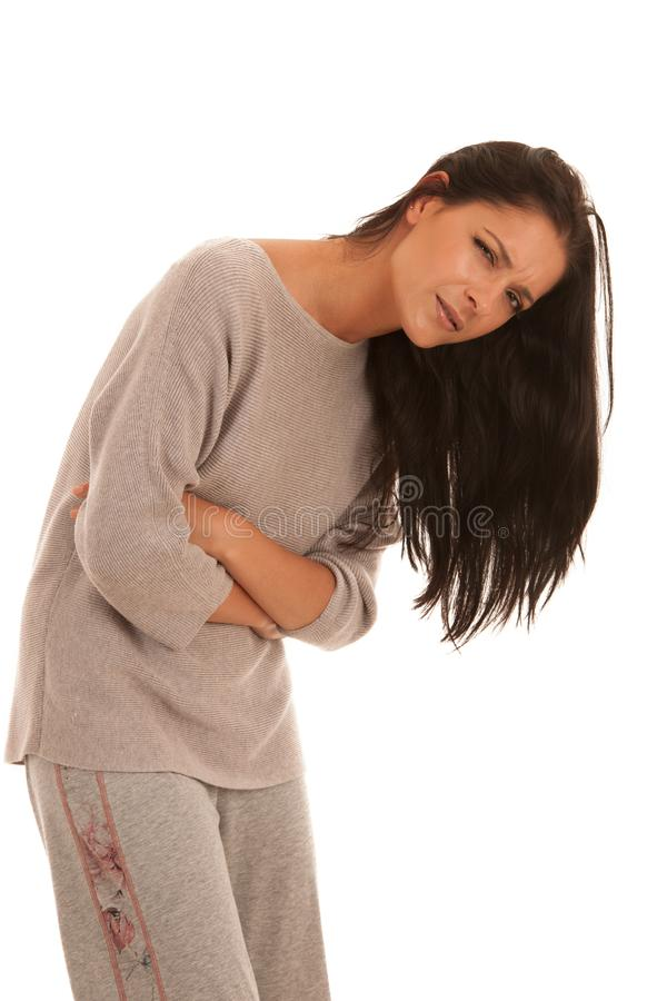 Young woman with stomach ache suffering isolated over white back royalty free stock photography