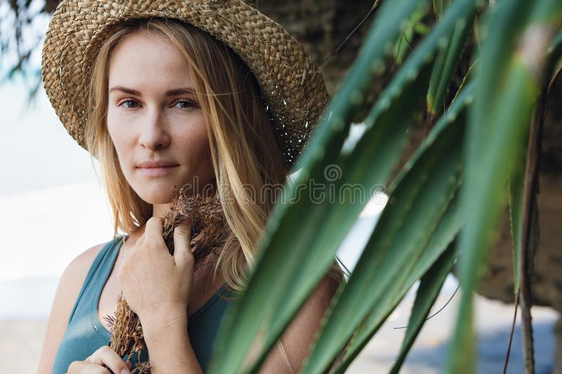 Young woman in straw hat hold bouquet of dried wildflowers royalty free stock photography