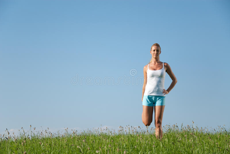 Young woman streching royalty free stock photography
