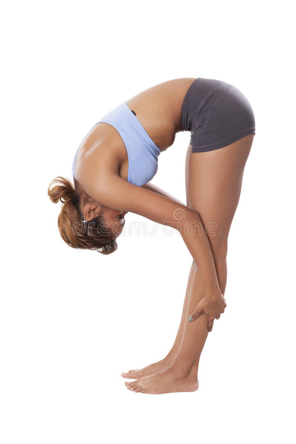 Young woman stretches before Yoga. royalty free stock photos