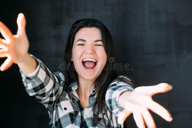 Young woman stretching arms happiness excitement royalty free stock photo