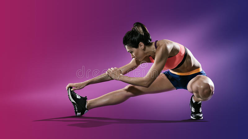 Young woman stretching her leg. royalty free stock image