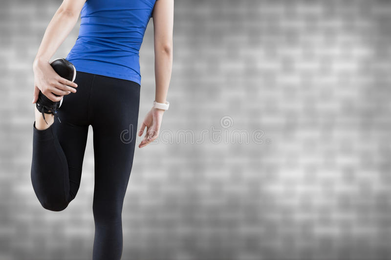 young woman stretching legs before yoga fitness exercise copy sp royalty free stock images
