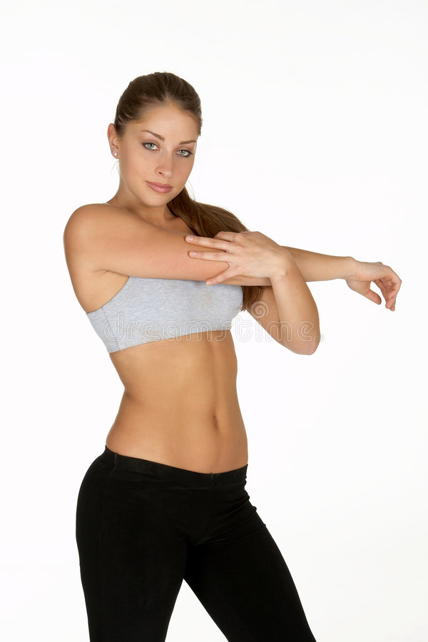 Download Young Woman Stretching Shoulder Stock Photo - Image: 978574