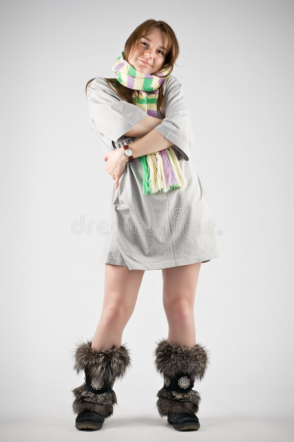 Young woman in striped muffler royalty free stock image