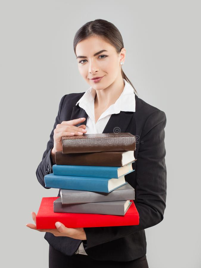 Young Woman Student with Book on Gray stock photography