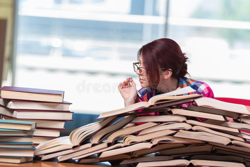 The young woman student preparing for college exams royalty free stock photo