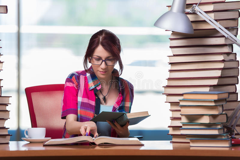 The young woman student preparing for college exams royalty free stock photos