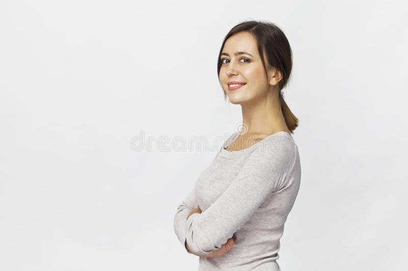 Young woman studio portrait. Confidence woman with crossed arms stock photo