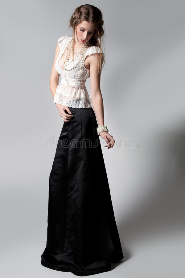 Young woman in stylish dress stock image