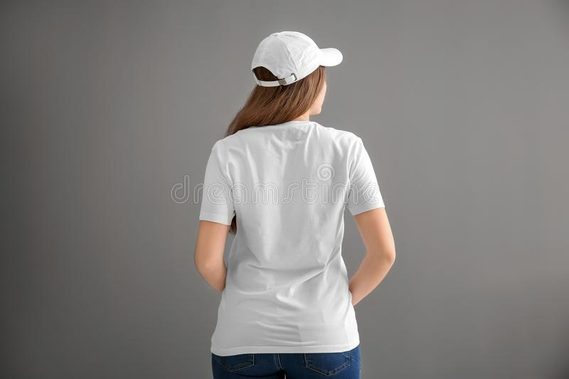 Young woman in stylish t-shirt and cap stock images
