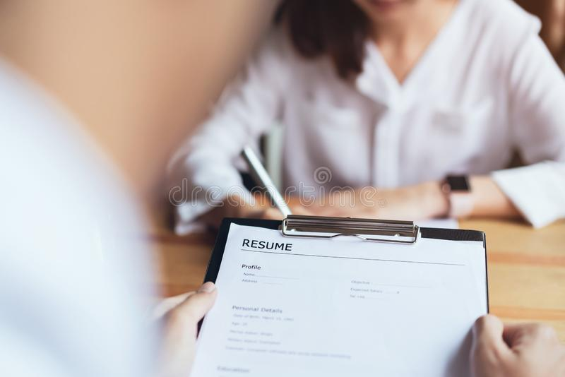 Young woman submit resume employer to review job application. royalty free stock image