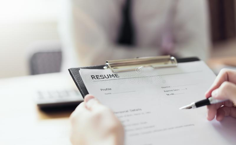 Young woman submit resume employer to review job application. royalty free stock photo