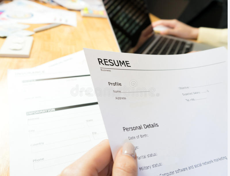 Young woman submit resume to employer to review job application. stock image