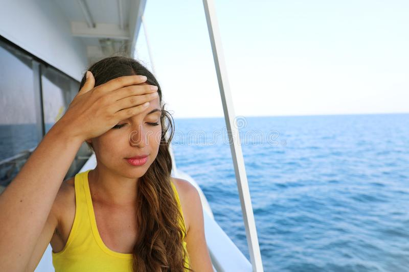Young woman suffer from seasickness during vacation on boat. royalty free stock images