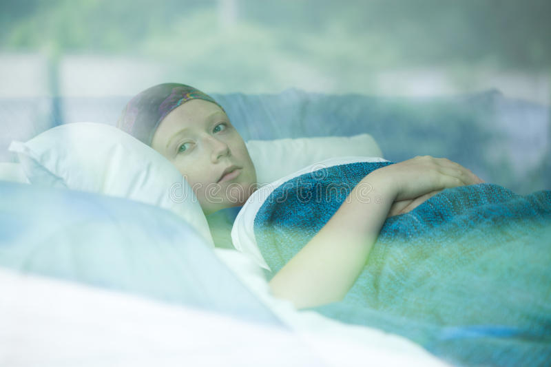 Young woman suffering from cancer stock photography