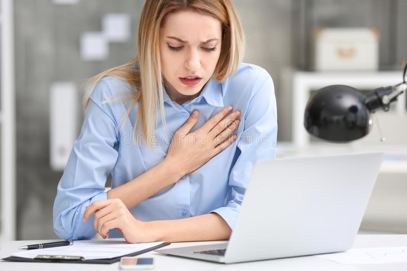 Young woman suffering from chest pain stock photo