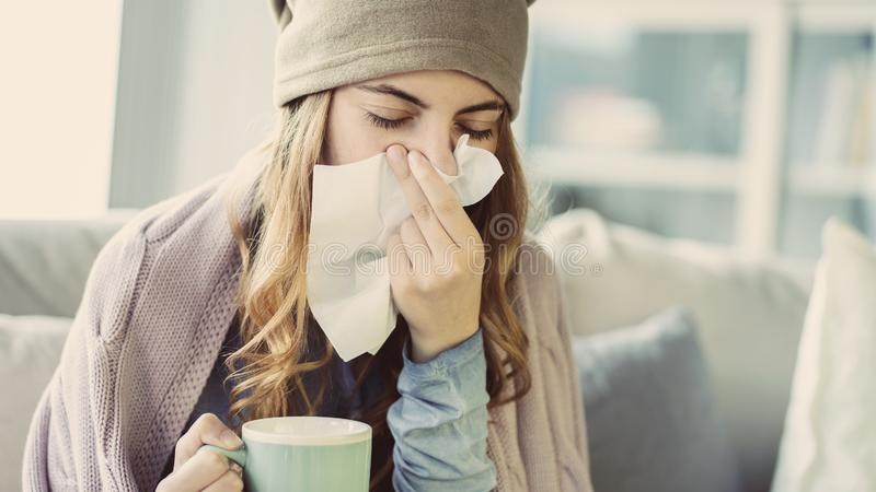 Young woman suffering from cold. Young woman suffering from  cold royalty free stock photos