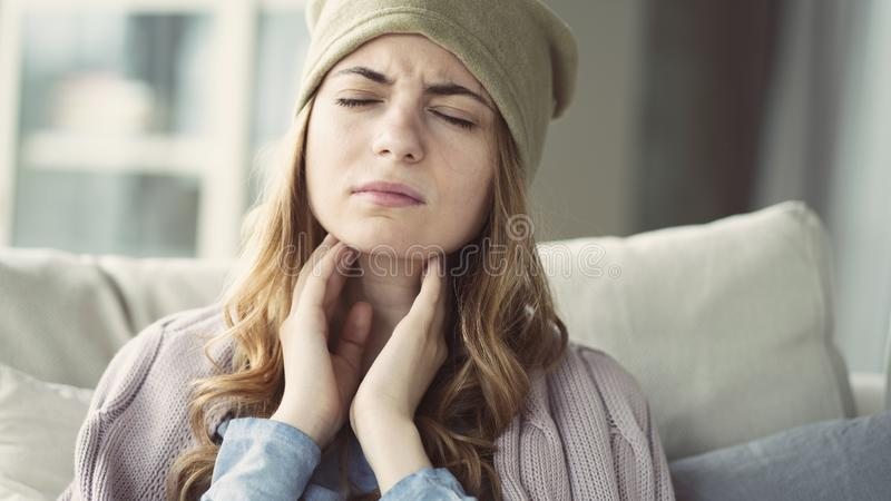 Young woman suffering from cold. Young woman suffering from  cold royalty free stock images
