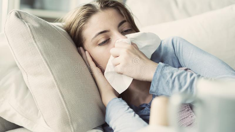 Young woman suffering from cold stock photography