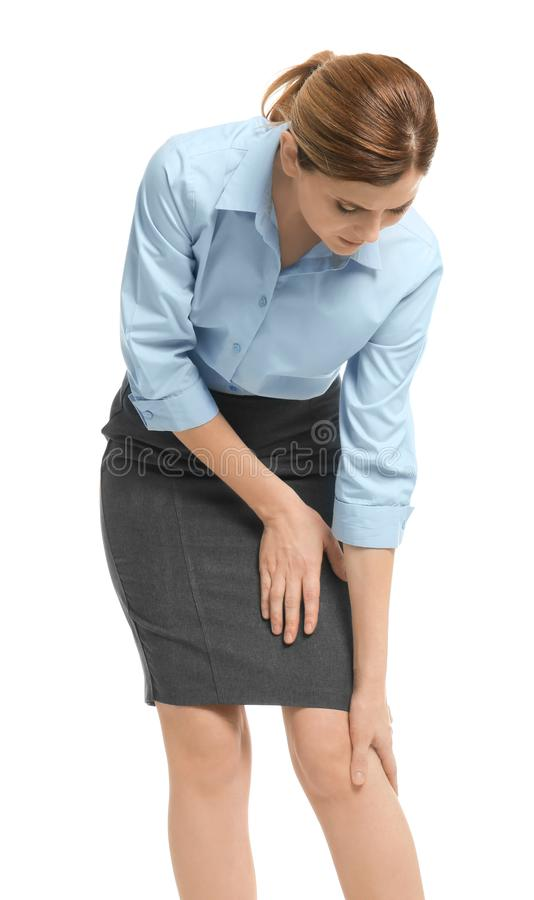 Young woman suffering from knee pain stock photography