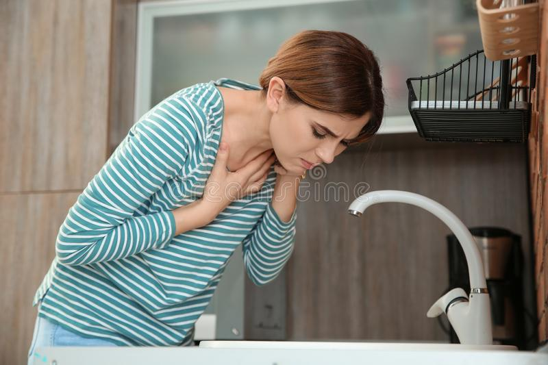 Young woman suffering from morning sickness. At home stock photography