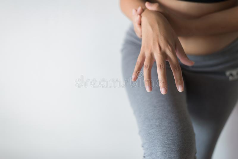 Woman suffering with parkinson`s disease symptoms stock images