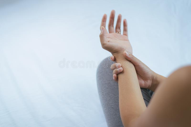 Woman suffering with parkinson`s disease symptoms,Selective focus hands. Young woman suffering with parkinson`s disease symptoms,Selective focus hands royalty free stock images